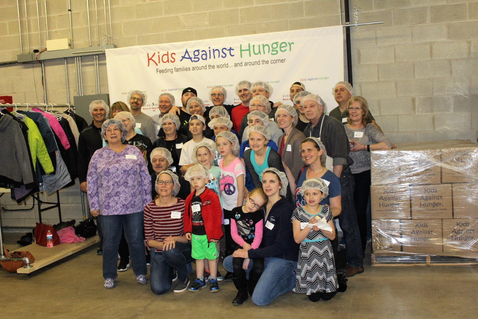 Atomatic Employees Pack 9,760 Meals for Kids Against Hunger